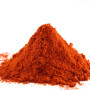 pile of ground paprika on white